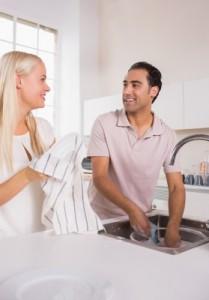 Couple-washing-dishes-together