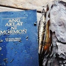 Family Baptized After Forgotten Book of Mormon Survives Fire